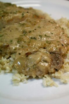 Tender chicken smothered in a creamy homemade onion and garlic gravy Whenever I make Southern Smothered Chicken, it reminds me of my childhood- when I lived in the 'hood. Every Sunday my mom … neck bones recipe soul food gravy Southern Smothered Chicken Pork Recipes, Crockpot Recipes, Cooking Recipes, Recipies, Yummy Recipes, Easy Pork Chop Recipes, Healthy Recipes, Amazing Recipes, Free Recipes