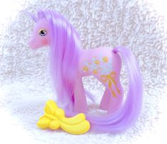 An absolutely STUNNING G1 Spring Song Sweetheart Sister Earth Pony! She comes with her original matching comb! She has little to no real notable flaws other than a mark on her one leg (in picture). Please see all pictures up close for a thorough representation of the item! I have TONS more cute vintage items for sale in my Etsy shop - check it out for SUPER CHEAP combined shipping discounts. ;) I ship WORLDWIDE from a clean, pet & smoke-free home! Please note that shipping times will be…