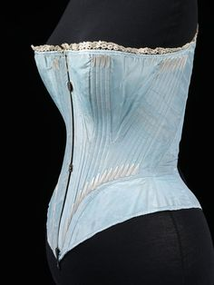 "1864 blue silk corset boned with whalebone. ""Possibly English or French,"" per V&A. Click through for MANY angles and closeups. [jrb]"