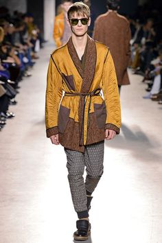 2b Dries Van Noten Fall 2013 Menswear. The cinched in waist of this mens coat could have come from the inspiration seen in mens new market jacket or frock coat that a cinched in waist and built up sloping neckline.