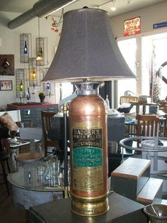 Top off your mancave or basement with this antique fire extinguisher lamp.