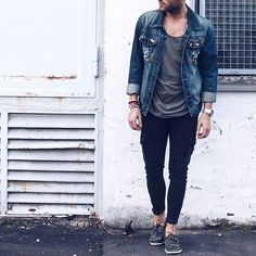 black pants, a grey tee, a denim jacket and brown moccasins