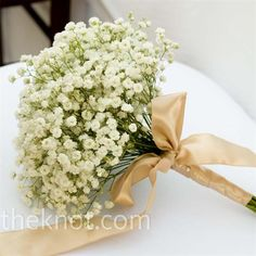 delicate baby's breath wrapped with champagne ribbon. Round and neat.