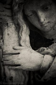 black and white angel grave stone