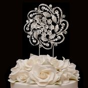 Take a look at this piece of cake jewelry like you've never seen it before! A floral ornament design is featured in luminous Sterling silver plating and is completely encrusted with dozens of sparkling rhinestone crystals as they lie into leaves, sprigs and a whirling designs.  Dimensions: Height: (Decoration: 4'') (Stem: 5'') (Total Height 9'') x Width: 4''.
