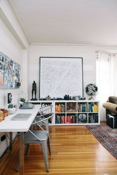 Mid-century inspired workspace. Love the camera display on the white IKEA Expedit bookcase. #office