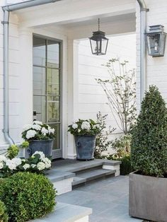 Via front porch plants morning sun spring curb appeal. Front Porch Plants, Front Door Planters, House With Balcony, House Porch, Porch Roof, Farmhouse Front Porches, Rustic Farmhouse, Farmhouse Style, Building A Porch
