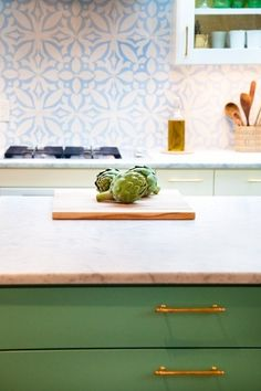 green kitchen cabinets with brass pulls