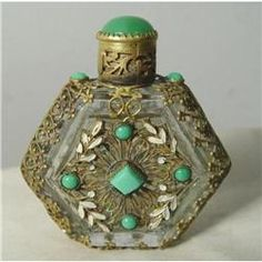 """Gorgeous Czech perfume bottle with enamel, filigree and """"stones"""" which are all present. Gold colored filigree wraps around the whole bottle."""