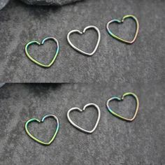 Soul Wired Heart Ear Piercing in Silver and Rainbow for Rook Daith Cartilage… – jewelryyy, You can collect images you discovered organize them, add your own ideas to your collections and share with other people. Piercings For Girls, Ear Piercings Cartilage, Heart Piercing, Rook Earring, Cartilage Earrings, Forward Helix Piercing, Orbital Piercing, Safety Pin Earrings, Heart Earrings