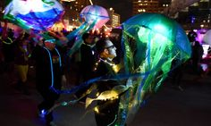 Illuminated jellyfish fashioned from umbrellas are seen in the Creative Alliance Light City Lantern Parade on Monday night. (Jerry Jackson/Baltimore Sun)