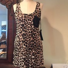 Animal print/laceracer back tank top Size M So cute, lace pocket, soft material, stretchy , good with leggings, jeans, shorts Tops Tank Tops