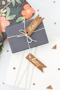 Love these wood veneer gift tags on a black package.