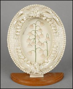 BELLEEK PORCELAIN OVAL PICTURE FRAME. : Lot 1282133 Irish Pottery, Belleek China, Belleek Pottery, Oval Picture Frames, Irish Decor, Love Lily, Beaded Ornaments, Tiny Flowers, Lily Of The Valley
