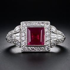 A ravishing, rich, red ruby (about as red as they come), weighing 1.75 carats, radiates from the center of this finely crafted platinum and diamond Art Deco ring.  The ring is intricately hand fabricated and displays exemplary craftsmanship throughout. The cuts of the diamonds are mixed (some are modern cut) and some may have replaced over the years, including the ruby, which is the cause of our uncertainty as to its exact vintage. Nevertheless, this is a breathtakingly beautiful and…