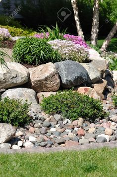 Stone Retaining Wall With Flowers And Shrubs Stock Photo Picture