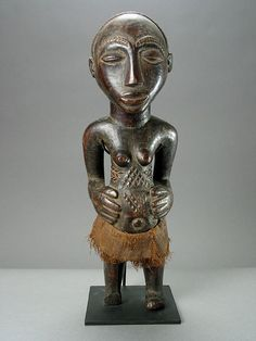Africa | Sculpture of a woman by the Hemba people of DR Congo | Wood and textile | 20th century