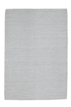 Laadukas matto, jossa klassinen hanhensilmäkuvio. Loimi puuvillaa.  <br><br>100% villaa<br>Imurointi