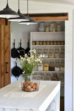 Farmhouse kitchen pantry with sliding barn door