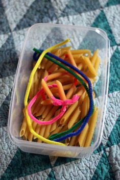 "Pasta threading with pipe cleaners for little kids... yarn with ""tape tip"" for older kids.... NICE!"