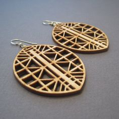 Part of our Truss collection, these geometric earrings are inspired by ancient bridge building techniques, but are entirely modern in the materials and methods used. Very lightweight, with a boho tribal style, these statement earrings wont weigh you down.  DETAILS  - 14k gold filled ear wires  - Laser cut wood - Birch - Length 2  - Width 1.75  Your item will arrive carefully packaged in a gift box, perfect for giving to yourself, or others! Wood is a natural material with a beautiful grain…