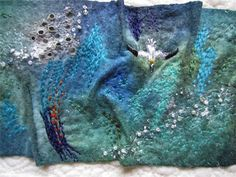 My work is inspired by the natural world. I specialize in meticulous hand embroidery and machine embroidery. I focus on the micro world of a mossy stone or barnacled shell.