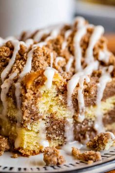 Sour Cream Coffee Cake, with a Ridiculous Amount of Streusel from The Food Charlatan. This is my FAVORITE recipe for Sour Cream Coffee Cake! My main complaint with Coffee Cake is that there is usually too much cake, not enough streusel. This recipe gives you the max amount of streusel without ruining the light fluffiness of the cake! A vanilla drizzle finishes it off! #coffeecake #sourcream #icing #frosting #drizzle #easy #recipes #cinnamon #streusel #sourcream #crumb #crumble #moist #breakfast Easy Cake Recipes, Dessert Recipes, Desserts, Bread Recipes, Food Cakes, Cupcake Cakes, Cupcakes, Sour Cream Coffee Cake, Bowl Cake