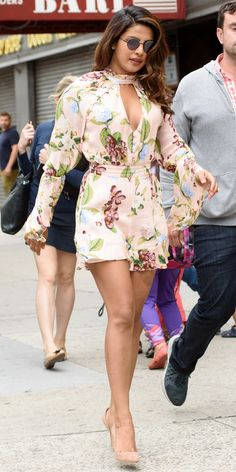 Priyanka Chopra is back at it again with the chic summer looks. While out in New York City, Chopra donned a pastel pink romper with flowing sleeves and a keyhole neckline, nude pumps, and on-trend round sunglasses. Bollywood Actress Hot Photos, Bollywood Fashion, Bollywood Stars, Baywatch Outfit, Priyanka Chopra Hot, Indian Celebrities, Celebrity Look, Beautiful Indian Actress, Indian Beauty