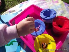 Painting with Feathers...exploring a different texture for toddlers challenged by sensory difficulties