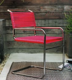 Next time you see a metal chair frame at the thrift store, consider this cute solution spied in the March issue of Sunset. All you need are a couple of garden hoses, some spring clamps and stainless steel zip ties.