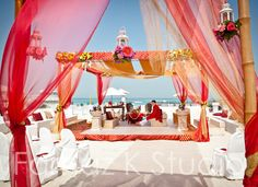 melon pink mandap on the waterside