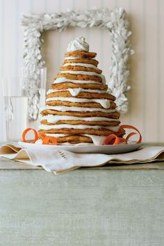 Carrot Cake Pancakes | Whimsical layer cakes for breakfast (and lunch and dinner)? Yes! We've transformed six classic Southern cakes into the most magical pancakes and toppings ever. Now get stacking. This Christmas, give your family (and yourself!) an unforgettable gift: a fluffy stack of pancakes covered in sweet, syrupy, downright decadent toppings. We've transformed six classic Southern cakes into the most magical Christmas pancakes combinations you've ever imagined. Fans of the iconic…