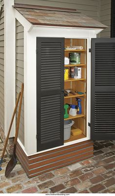 Outdoor shed with shutters built right next to the house...a fabulous way to get your garden/project tools and supplies out of the garage space!