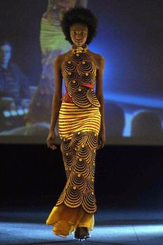 African inspired Haute Couture.<<This dresses colors bring out her highlighted skin tone>>>