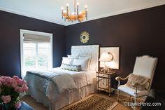 black bedroom with leopard print rug