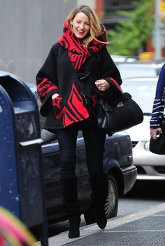 Blake Lively looks cozy in a black and red coat. See more of her maternity looks here.
