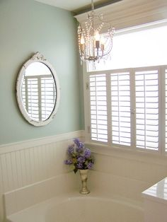 using window shutters for the bathroom window.yes Love this for our addition we are gonna build for master bathroom!