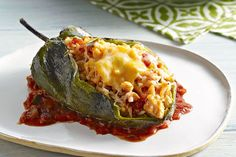 Large poblano chiles get a stuffing of chicken, cheese and chunky salsa and emerge from the oven hot, melty and delicious!