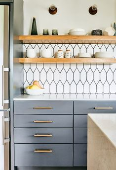 Beautiful moody gray kitchen with white elongated hex tile backsplash and open s. Beautiful moody gray kitchen with white elongated hex tile backsplash and open shelving in natural wood, add gold hardware for extra warmth! Kitchen Ikea, Blue Kitchen Cabinets, Home Decor Kitchen, Kitchen Furniture, Kitchen Interior, Home Kitchens, Studio Kitchen, Rustic Kitchen, Kitchen Modern