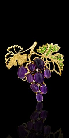 Brooch 10400 Collection: Fruits and berries  18K yellow and white gold, amethysts 46,52 ct, diamonds, green diamonds, yellow diamonds, tsavority, demantoids.