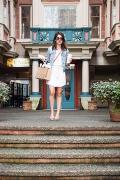 PERFECT spring/summer outfit! You can't go wrong with dressing up a casual jean jacket and white spring dress with a cute pair of pumps.