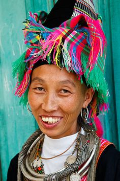 Vietnam   Portrait of a H'mong hill tribe woman wearing traditional clothing and headdress, located in Sin Ho market which is held every Sunday   © Kimberley Coole