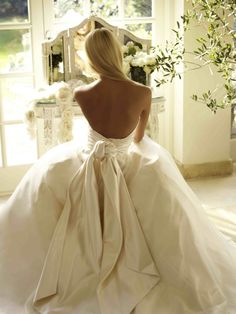 Phillipa Lepley. Baby Olivia with knot and tails. Bespoke low back corseted gown. www.phillipalepley.com