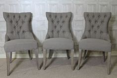 These button back French style Versailles dining chairs feature an opulent and rich upholstery work with a quality mushroom grey linen material. The...