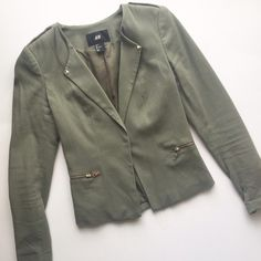 H&M khaki green fitted detail blazer jacket H&M fitted khaki green blazer with bottom closure front.  Great gold stud details on arms & slimming zippers on sides .  Stylish utility details throughout & slim fit with stretch.  I have too many green jackets  pre used condition (worn a handful of times) with a few pills throughout from washing.  No stains or tears H&M Jackets & Coats Blazers