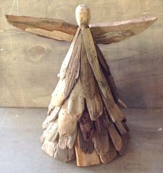 """This Driftwood Angel is a beautiful hand crafted piece of art that gives a rustic beach feel to any room. This angel is hand crafted and assembled with tiny nails. Approximate Measurements: 12.5""""x 11."""