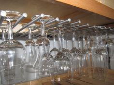 I'm wanting to turn my baker's rack into a wet bar! Thought this could be fun for glasses -- use dowel rods?