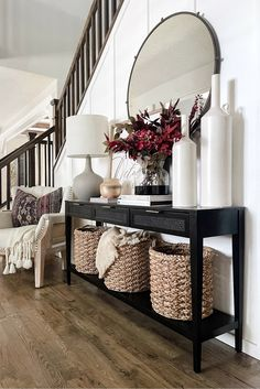 Add the perfect finishing touch to your fall home decor by styling your console table with some artificial fall leaves. Bring in the colors of fall without the mess. Shop artificial fall leaves at Afloral.com. Image by @greybirchdesigns.