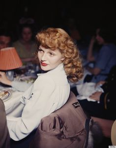 Rita Hayworth, 1944: Hayworth was one of the first film sirens to turn the red lip into a signature look. Many stars would follow suit...rita hayworth
