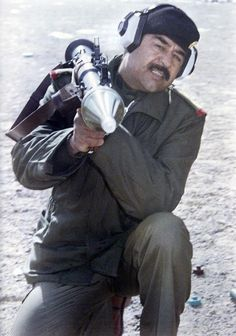 Saddam Hussein practices launching a RPG during the Iran-Iraq war